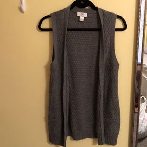 grey sleeveless sweater with buttons